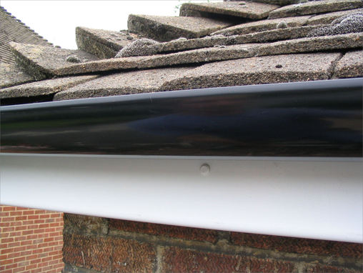 Popular choice standard black high gloss guttering fitted to maintenance free white upvc fascias.